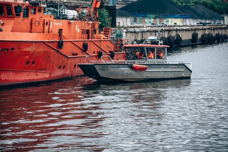 Saint Petersburg, Russia - July 30, 2019: the Doctrine on liquidation of oil spill in the sea port. Rescue service at work.