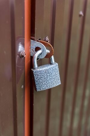 Padlock on the door close - up-the concept of protection Stok Fotoğraf
