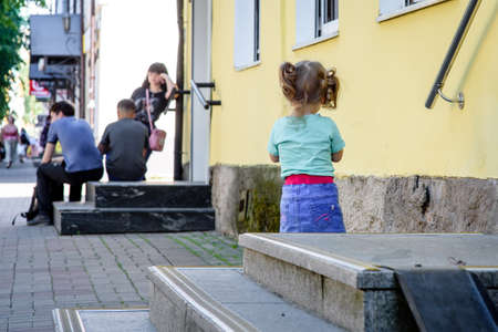 Russia, Gatchina, June 25, 2020: people walk along the city streets. Life after quarantine. Blurred background.