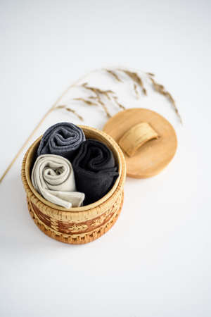Men's socks in a round box on a white background - close-up