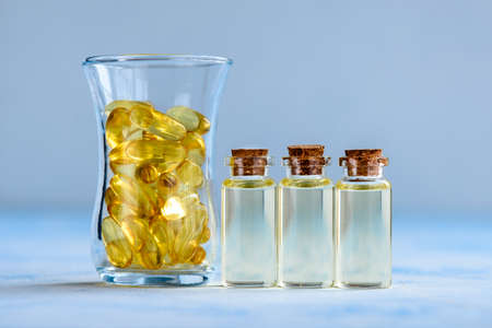 Fish oil capsules on a blue background - omega 3 vitamins and health concept