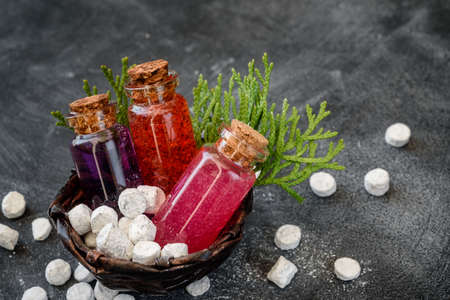 Shower gel in glass bottles and bath salt on a dark background. Spa products and body care. Stok Fotoğraf