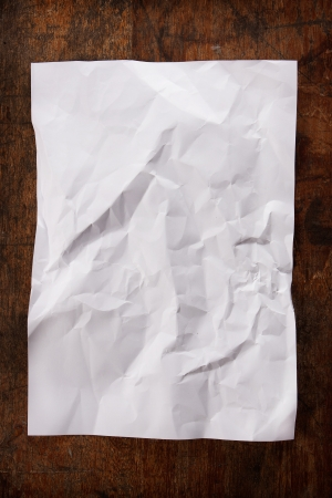 crumpled paper on wood table