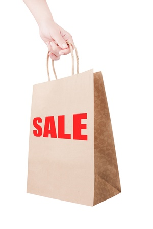 holding discount shopping paper bag