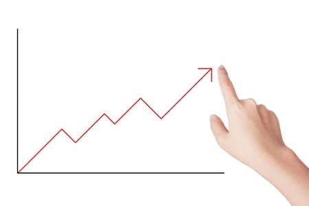 Arrow Graph grow up with human hand Stock Photo