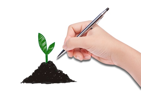 human hand drawing a plante Stock Photo