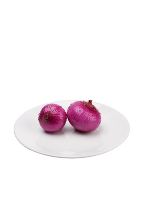 fresh red onion on a plate