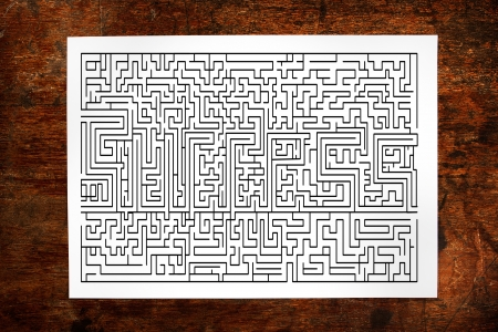 Channel maze game on wood background Stock Photo