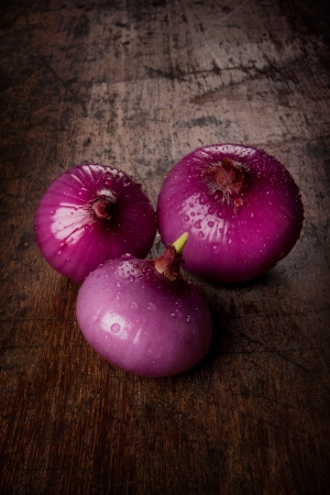 red onions on wood table