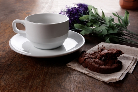 coffee and cookie with flower on wood table Stock Photo
