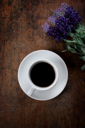 coffee with flower on wood table Stock Photo