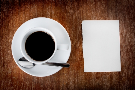 coffee meeting: coffee with note paper on wood table Stock Photo