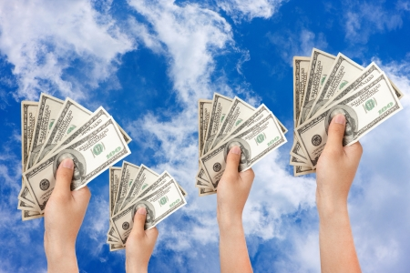human hand with money sky background