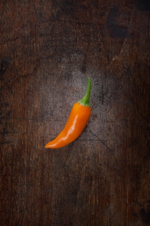 orange chili on wood background Stock Photo