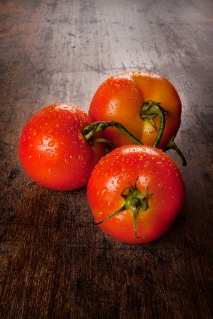 fresh tomatos on wood background