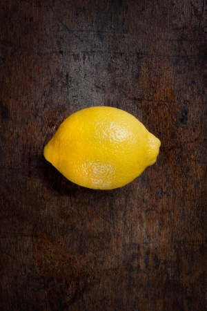 Big fresh lemon on wood background