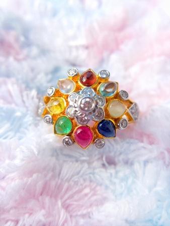 A ring nine gems. Stock Photo