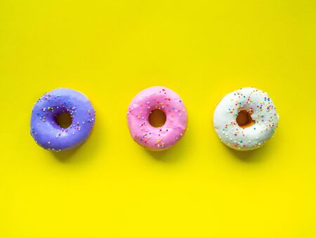 Donuts various flavor have color Orange White Purple Pink, High energy foods and healthy rates, Sweet flavored candy, Mapping background
