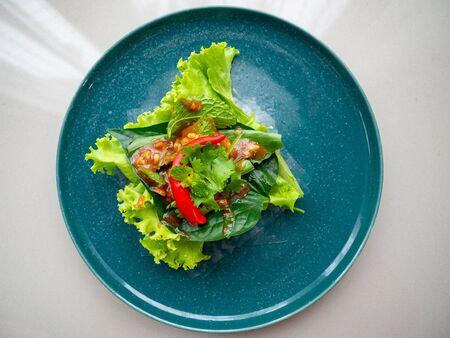 Food name is Nham Nueng is a national dish of Vietnamese people. Is a healthy food The main raw materials are Lettuce Coriander, saw blade, chili,coriander.