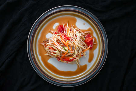 Papaya Salad menu, the main ingredient is papaya Is healthy food You can find it in street food stalls, a local dish in Thailand It is a popular food.