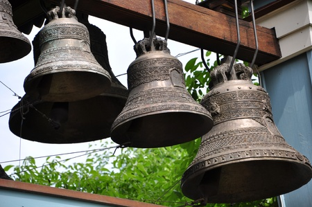 a number of bronze bells in the belfry photo
