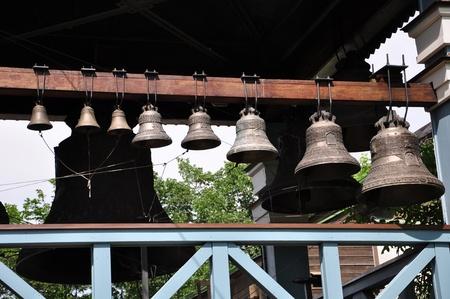 a number of bronze bells in the belfry