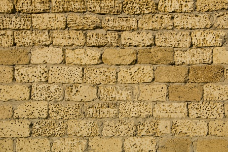 wall of bricks laid in cement sand photo