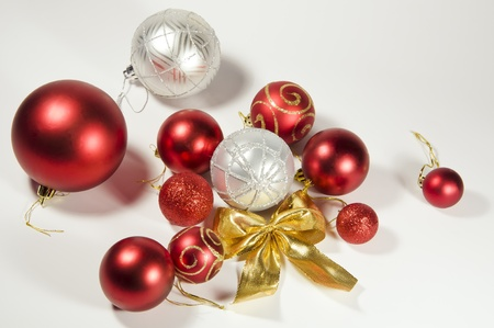 a set of Christmas toys with a festive bow