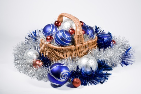 Christmas toys are in a wicker basket Stock Photo