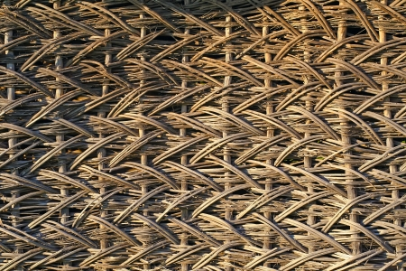 wattle: Detail of old wicker fence. Texture of wooden handmade hedge.