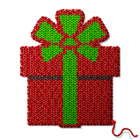 stockinet: Gift symbol of knitted fabric isolated on white background. Fragment of knitting in shape of gift box.