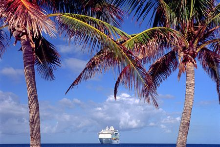 cruise ship between two pulms  in Caribbean sea Stock Photo