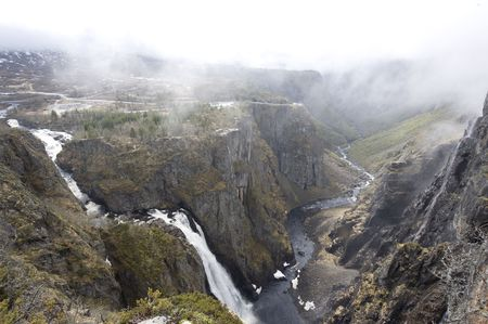 Smoke above river in Norway canyon