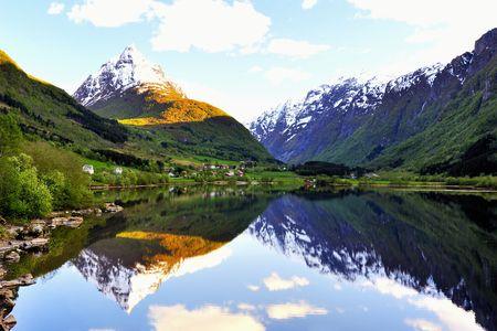 Norway village between lake and  mountains