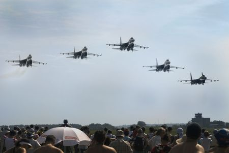 Airshow in Zhukovckiy (Russia). Five military fighters above the crowd