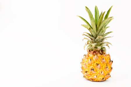 Phulae, small pineapple fromThailand on white background