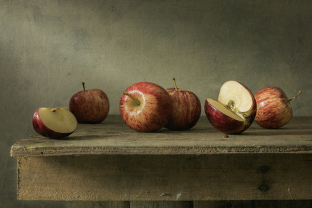 Still life with apples on wood table