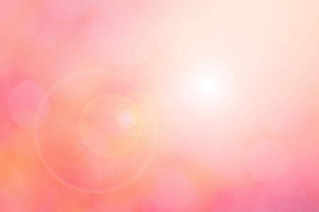 Blur pink background with lens flare effect