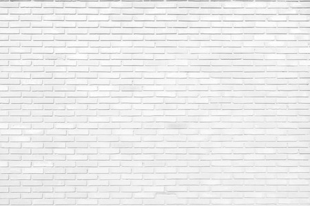 White brick wall texture as a background Imagens