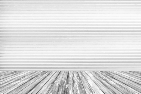 shutter door: Wood terrace with white metal roller shutter door as a background Stock Photo