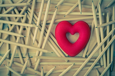 Vintage photography with red heart and wood pencil on wood board background Фото со стока