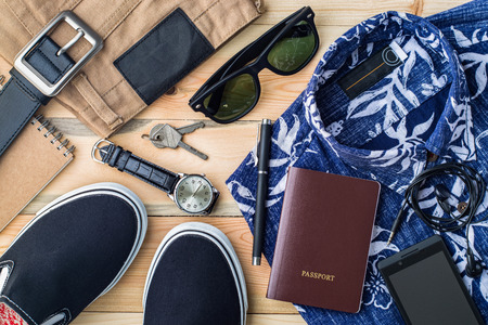 Overhead view of men's casual outfits, Outfits of traveler, boy, female, Men's casual outfits on wood board background