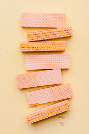 Wafers on orange paper background