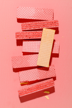 Colorful Wafers on pink paper background