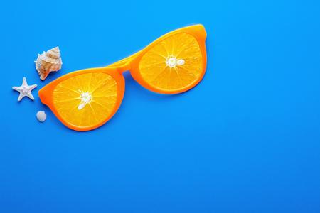 Beach sunglasses on blue background, Summer concept Фото со стока