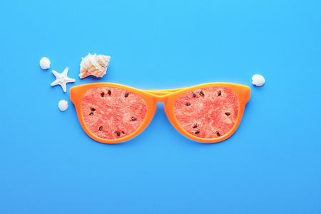 Beach sunglasses on blue background, Summer holiday concept