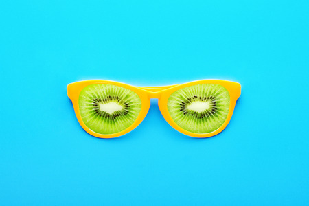 Beach sunglasses on a blue background. Summer holiday concept