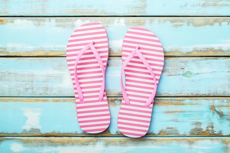 Pink Beach flip flop on white wooden floor