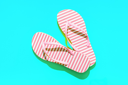 Pink Beach flip flop on turquoise background