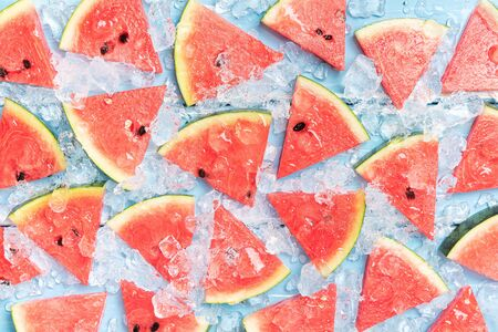 Watermelon slice on a blue rustic wood background